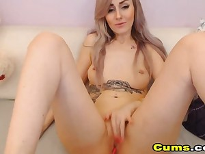 Blonde girl in front of a web camera masturbating