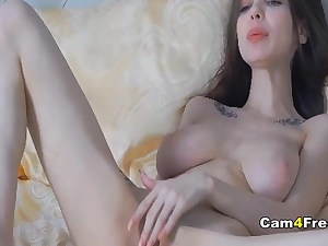 Super lovely brunette on the bed deepthroating a good-sized sex toy